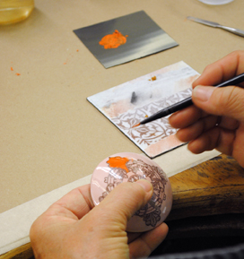 Demo; Jan painting sunshine color on a piece with a fired decal_2