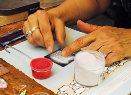 Demo; dichroic glass being placed in sifted enamel for firing