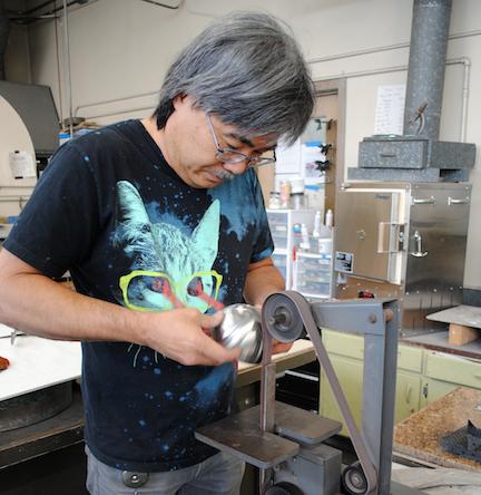 Ed Lay sanding stainless steel bowl